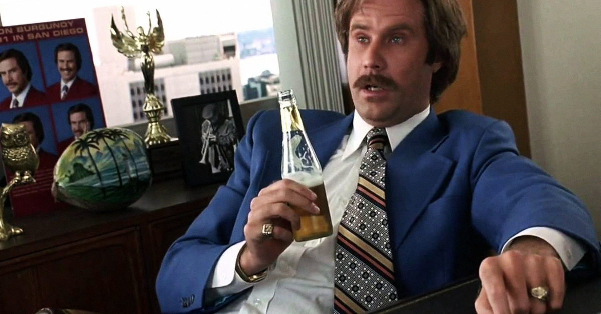will farrell as ron burgandy sits back in a colourful seventies suit with a bottle of beer, remarking that the situation escalated quickly