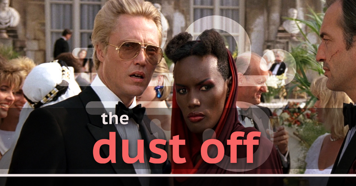 christopher walken as max zorin and grace jones as mayday stare offscreen, conspiring against bond